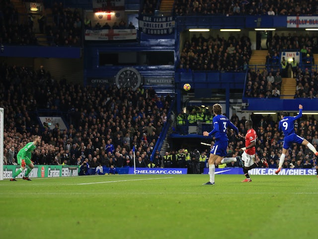 Alvaro Morata scores the opener during the Premier League game between Chelsea and Manchester United on November 5, 2017