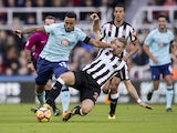 Bournemouth striker Callum Wilson holds off the challenge of Newcastle United defenders Florian Lejeune during their Premier League clash at St James' Park on November 4, 2017
