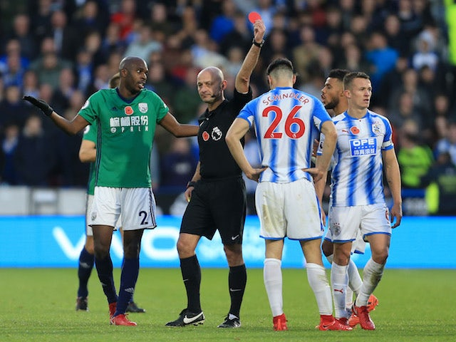Christopher Schindler is shown a red card during Huddersfield Town's Premier League clash with West Bromwich Albion on November 4, 2017