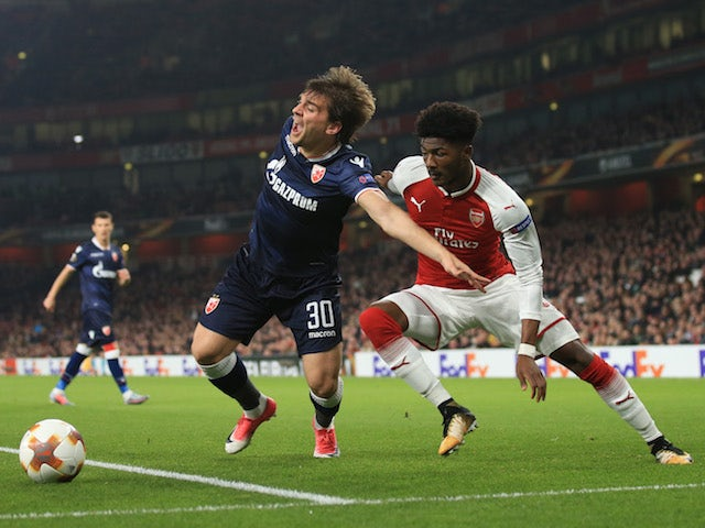 Filip Stojkovic and Ainsley Maitland-Niles in action during the Europa League group game between Arsenal and Red Star Belgrade on November 2, 2017