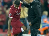 Georginio Wijnaldum talks to Jurgen Klopp as he comes off injured during the Champions League group game between Liverpool and Maribor on November 1, 2017