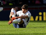 Harry Winks nurses an injured leg during the Premier League game between Tottenham Hotspur and Crystal Palace on November 5, 2017