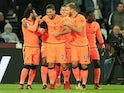Joel Matip is congratulated by teammates after scoring during the Premier League game between West Ham United and Liverpool on November 4, 2017