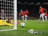 Mile Svilar saves a penalty from Anthony Martial during the Champions League group game between Manchester United and Benfica on October 31, 2017