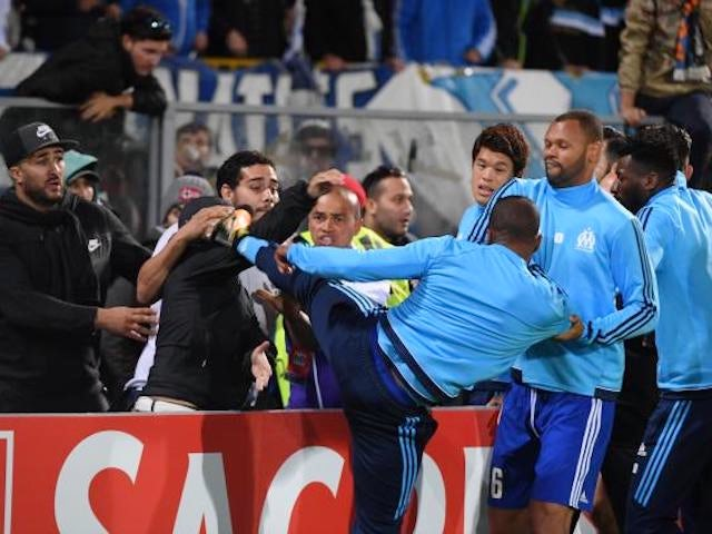 Patrice Evra kicks a Marseille fan in the face ahead of his side's Europa League clash on November 2, 2017