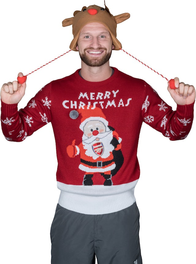 Shkodran Mustafi poses for the Save The Children's Christmas Jumper Day