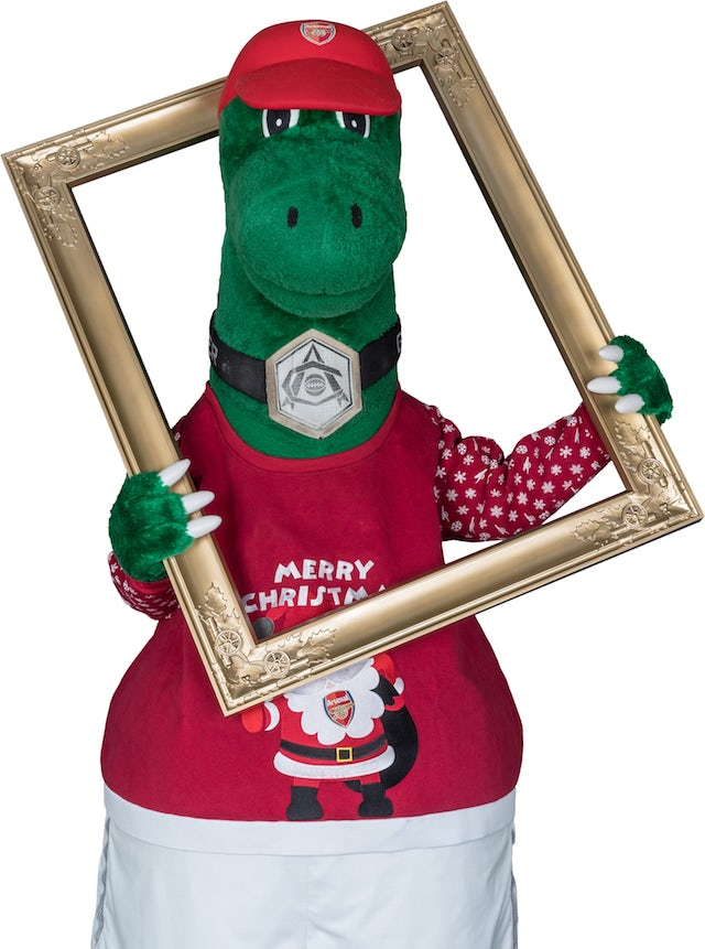 The Gunnersaurus poses for the Save The Children's Christmas Jumper Day