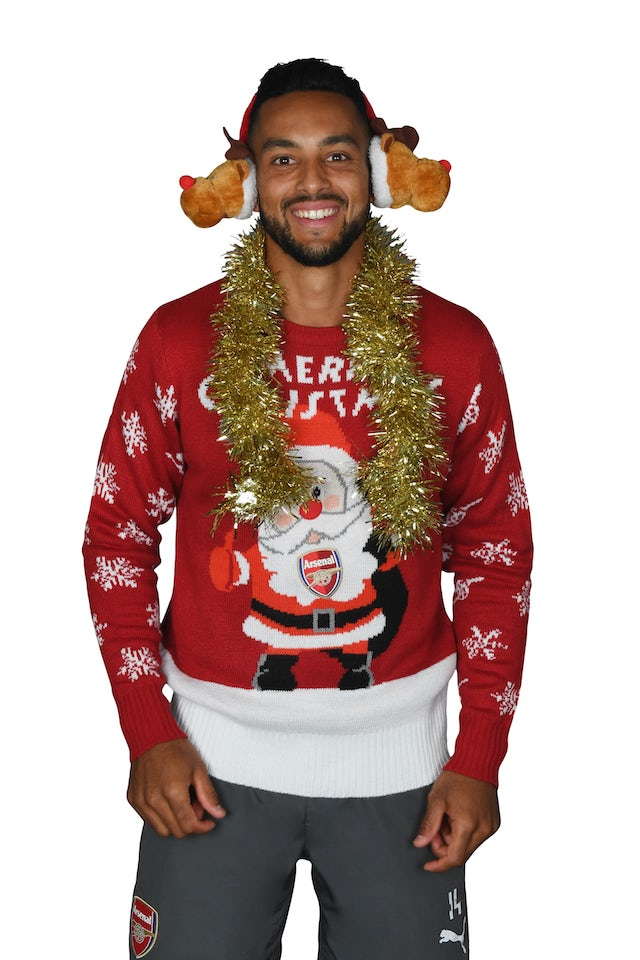 Theo Walcott poses for the Save The Children's Christmas Jumper Day
