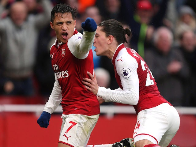 Alexis Sanchez celebrates scoring with Hector Bellerin during the Premier League game between Arsenal and Tottenham Hotspur on November 18, 2017