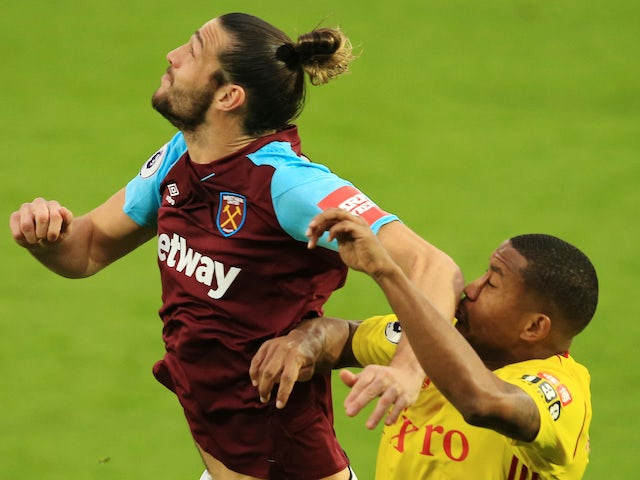 Andy Carroll elbows Marvin Zeegelaar in the face during the Premier League game between Watford and West Ham United on November 19, 2017