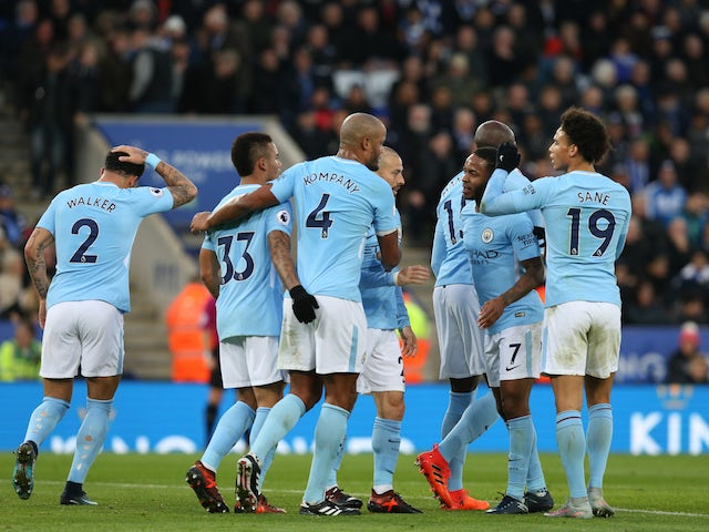 Gabriel Jesus is congratulated by teammates after scoring during the Premier League game between Leicester City and Manchester City on November 18, 2017