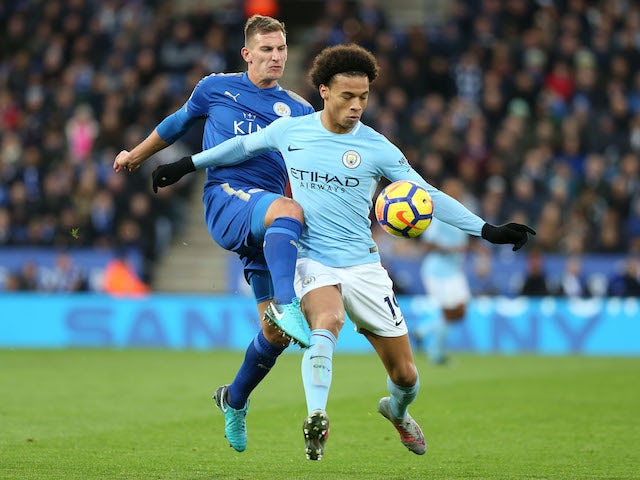 Marc Albrighton and Leroy Sane in action during the Premier League game between Leicester City and Manchester City on November 18, 2017
