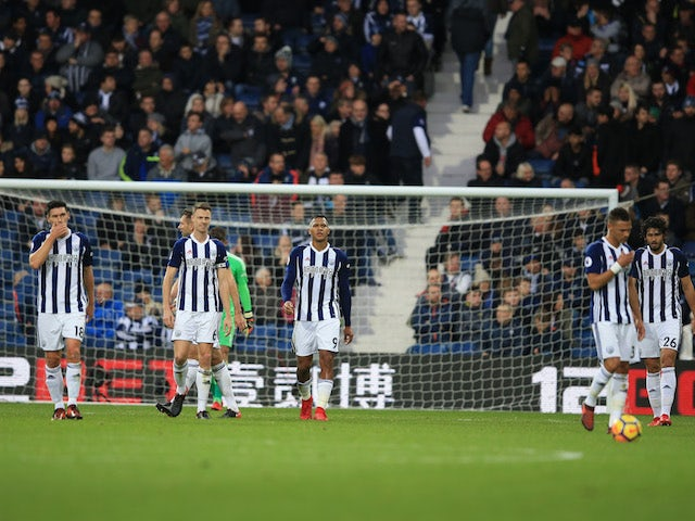 Baggies players looking dejected after conceding a third during the Premier League game between West Bromwich Albion and Chelsea on November 18, 2017