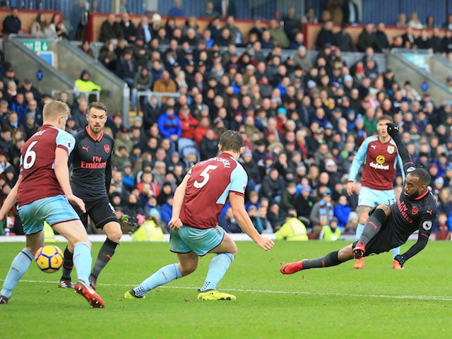 Alexandre Lacazette slips as he shoots during the Premier League game between Burnley and Arsenal on November 26, 2017