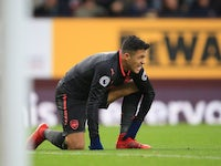 Alexis Sanchez winces during the Premier League game between Burnley and Arsenal on November 26, 2017