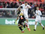 Alfie Mawson and Jordon Ibe in action during the Premier League game between Swansea City and Bournemouth on November 25, 2017