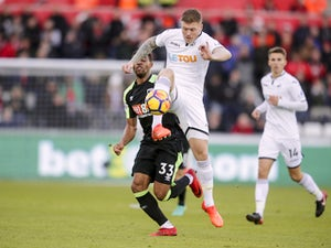 Alfie Mawson undergoes knee surgery