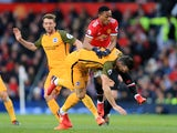 Anthony Martial collides with Shane Duffy during the Premier League game between Manchester United and Brighton & Hove Albion on November 25, 2017