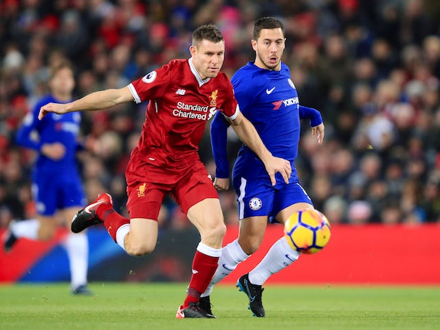 Eden Hazard and James Milner in action during the Premier League game between Liverpool and Chelsea on November 25, 2017