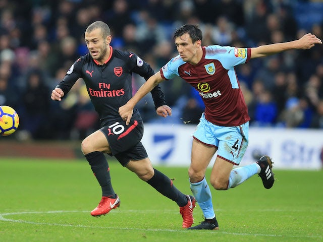Jack Wilshere and Jack Cork in action during the Premier League game between Burnley and Arsenal on November 26, 2017