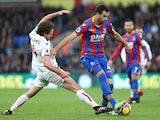 Joe Allen and Luka Milivojevic in action during the Premier League game between Crystal Palace and Stoke City on November 25, 2017