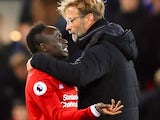 Jurgen Klopp deals with an unhappy Sadio Mane during the Premier League game between Liverpool and Chelsea on November 25, 2017