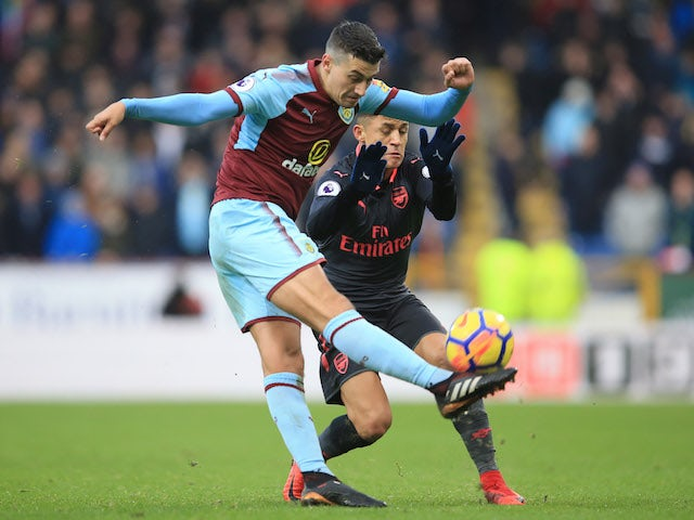 Matthew Lowton and Alexis Sanchez in action during the Premier League game between Burnley and Arsenal on November 26, 2017