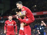 Mohamed Salah with Philippe Coutinho after scoring during the Premier League game between Liverpool and Chelsea on November 25, 2017