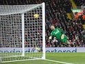Willian scores past Simon Mignolet during the Premier League game between Liverpool and Chelsea on November 25, 2017