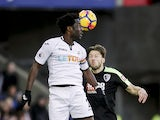 Wilfried Bony and Harry Arter in action during the Premier League game between Swansea City and Bournemouth on November 25, 2017
