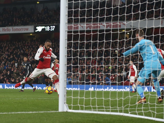 Alexandre Lacazette pulls one back during the Premier League game between Arsenal and Manchester United on December 2, 2017