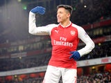 Alexis Sanchez celebrates during the Premier League game between Arsenal and Huddersfield Town on November 29, 2017