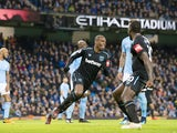 Angelo Ogbonna celebrates opening the scoring during the Premier League game between Manchester City and West Ham United on December 3, 2017