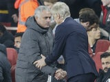 Arsene Wenger and Jose Mourinho share a tentative handshake during the Premier League game between Arsenal and Manchester United on December 2, 2017