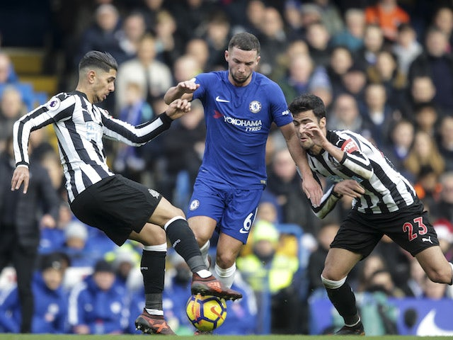 Ayoze Perez and Mikel Merino close in on Danny Drinkwater during the Premier League game between Chelsea and Newcastle United on December 2, 2017