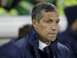Brighton & Hove Albion manager Chris Hughton watches on during his side's Premier League clash with Crystal Palace at the Amex Stadium on November 28, 2017