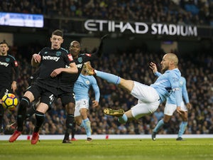 Man City battle to record-equalling win