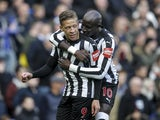 Dwight Gayle celebrates with Mohamed Diame after scoring during the Premier League game between Chelsea and Newcastle United on December 2, 2017