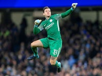 Ederson celebrates City's equaliser during the Premier League game between Manchester City and West Ham United on December 3, 2017