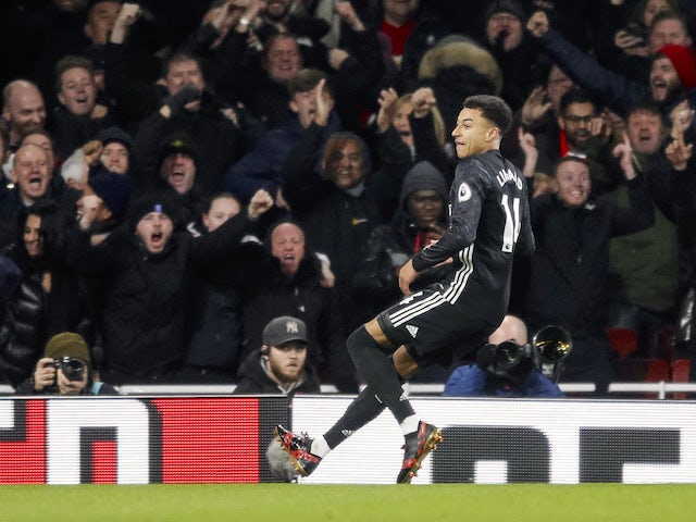 Jesse Lingard celebrates scoring the second during the Premier League game between Arsenal and Manchester United on December 2, 2017