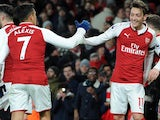 Mesut Ozil celebrates scoring with Alexis Sanchez during the Premier League game between Arsenal and Huddersfield Town on November 29, 2017