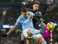 Nicolas Otamendi and Manuel Lanzini scrap it out during the Premier League game between Manchester City and West Ham United on December 3, 2017