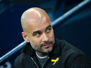 Guardiola dismisses 'champions-elect' tag