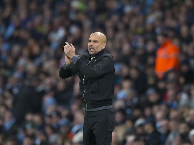 Pep Guardiola applauds during the Premier League game between Manchester City and West Ham United on December 3, 2017