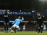 Oscar nominee Raheem Sterling goes down under a challenge for Arthur Masuaku during the Premier League game between Manchester City and West Ham United on December 3, 2017