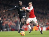 Romelu Lukaku and Aaron Ramsey in action during the Premier League game between Arsenal and Manchester United on December 2, 2017