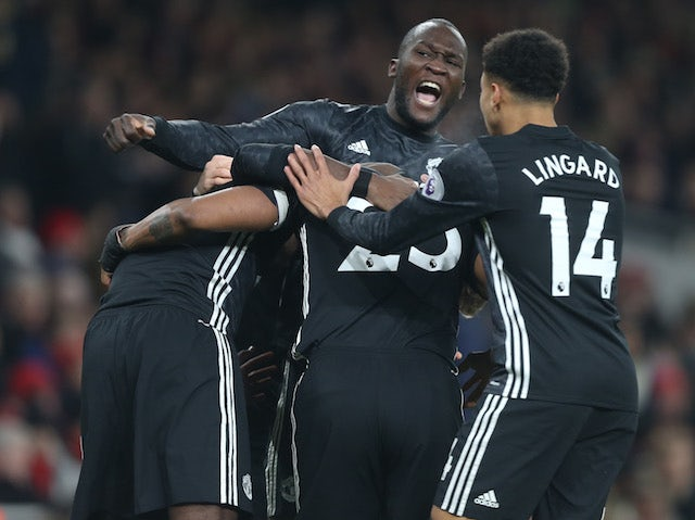 Romelu Lukaku celebrates Antonio Valencia's opener during the Premier League game between Arsenal and Manchester United on December 2, 2017