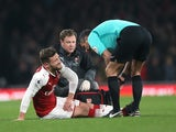 Shkodran Mustafi goes down injured during the Premier League game between Arsenal and Manchester United on December 2, 2017