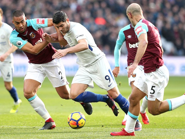 Alvaro Morata comes up against Winston Reid during the Premier League game between West Ham United and Chelsea on December 9, 2017