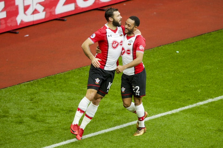 Charlie Austin celebrates with Nathan Redmond after scoring during the Premier League game between Southampton and Arsenal on December 10, 2017